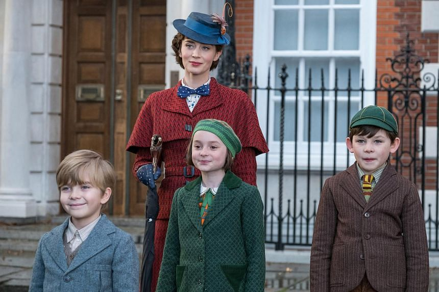 Mary Poppins, played by Emily Blunt (in red), is back to help the next generation of the Banks family find the joy and wonder missing in their lives following a personal loss.
