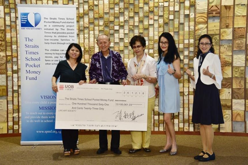 (From left) The Straits Times School Pocket Money Fund general manager Tan Bee Heong, Life Art Society founder and president Tan Khim Ser, Mrs Tan (Mr Tan's wife), Life Art Society treasurer Gladys Shan and ST reader Yang Shwn Fen at the cheque prese