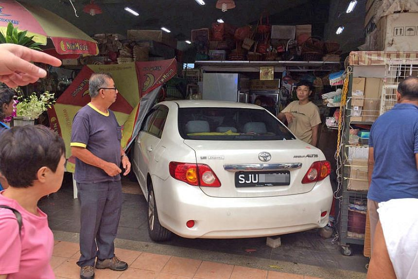 Lim Soon Wai lost control of his car and crashed head-on into a florist's stall in Marine Terrace market on Dec 9, 2017.