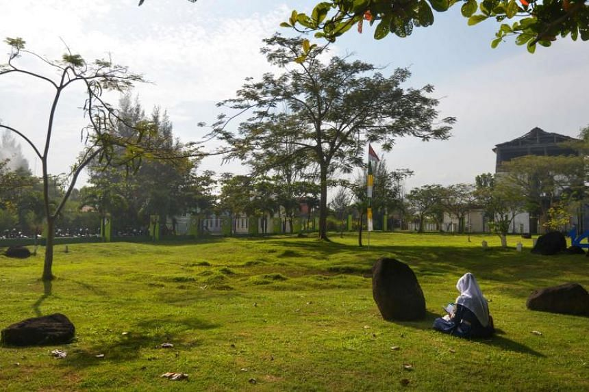 Nearly 47,000 are buried under a grassy field dotted with black rocks meant to symbolise a tomb.