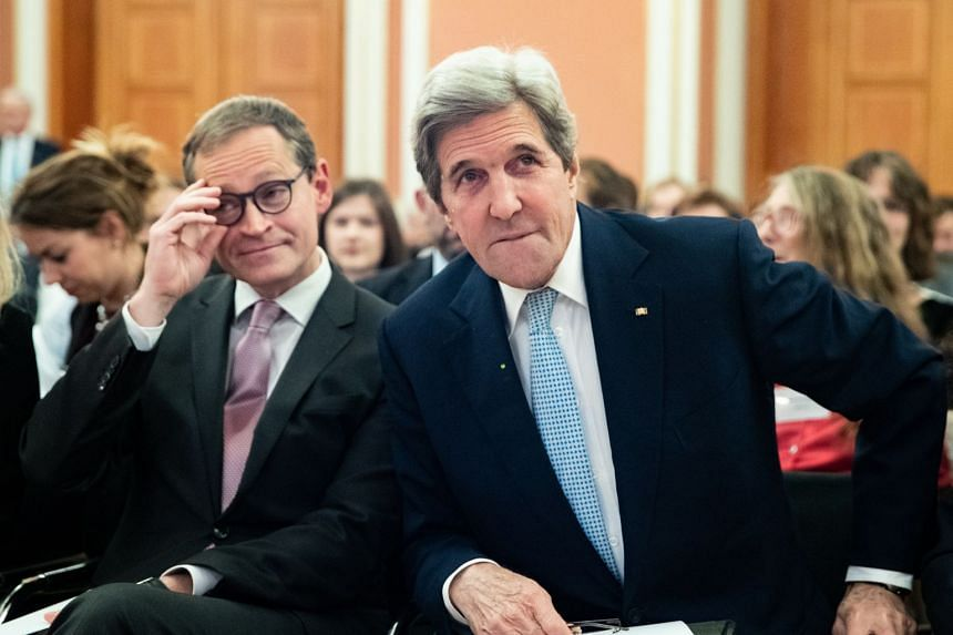 Former US secretary of state John Kerry (right) is pictured in Berlin, Germany on Dec 14, 2018.
