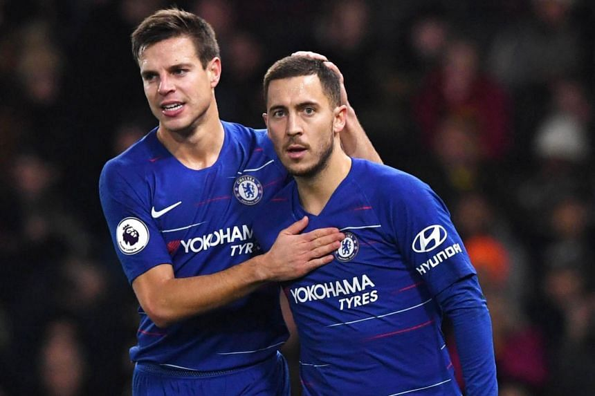 Chelsea's Eden Hazard (right) reacts with team-mate Cesar Azpilicueta after scoring a penalty.