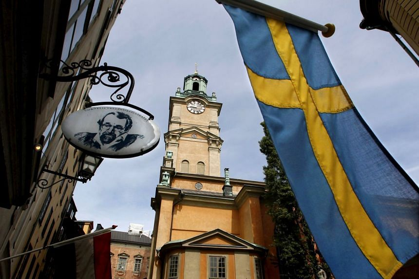 Sweden's flag is seen near the Stockholm Cathedral in the Old Town district of Stockholm, Sweden.