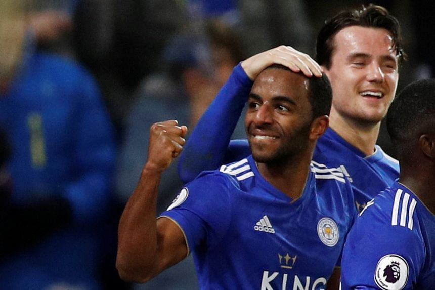 Ricardo Pereira celebrates scoring their second goal with Ben Chilwell.