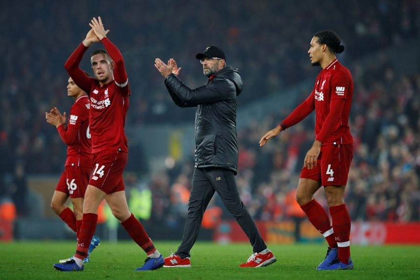Liverpool's Jordan Henderson and manager Juergen Klopp applaud the fans at the end of the match.