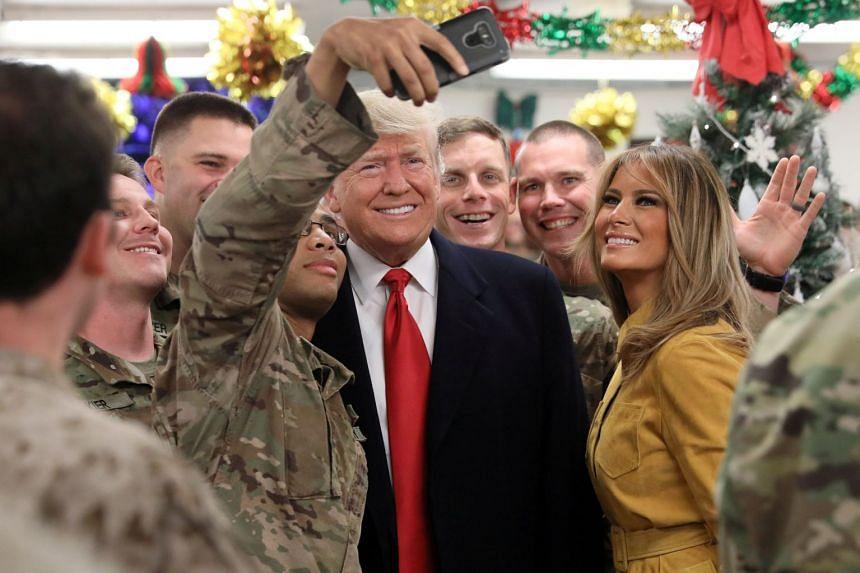 Donald and Melania Trump greet military personnel at Al Asad Air Base in Iraq.