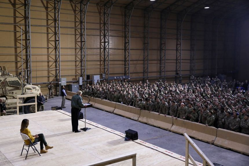 Trump delivers remarks to U.S. troops in an unannounced visit to Al Asad Air Base.