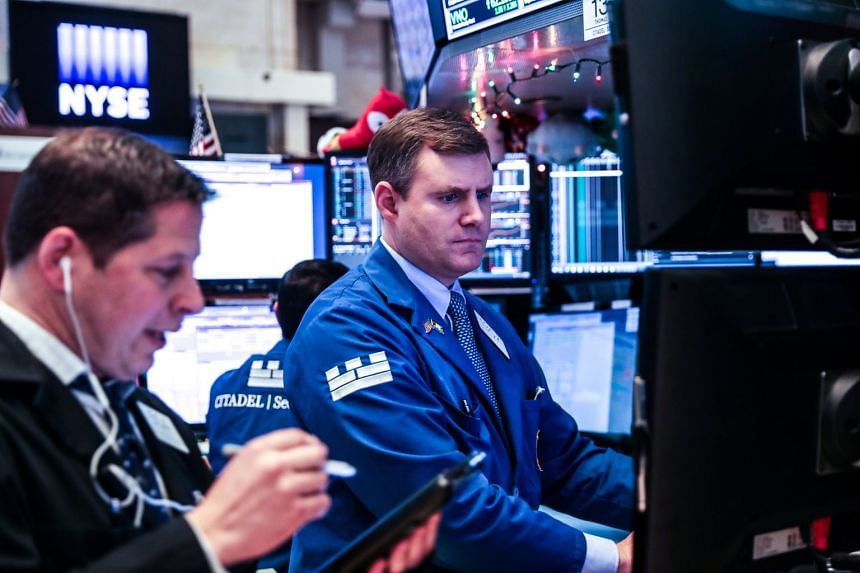 Traders work on the floor of the New York Stock Exchange, Dec 26, 2018.