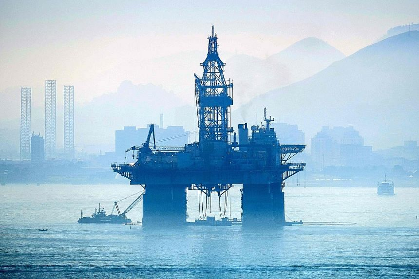 An oil drilling platform in Brazil. The Centre for Economics and Business Research expects Brazil to overtake Italy in 2020, and not this year. Its forecasts for next year chime with a deepening sense that optimism about synchronised global growth wa