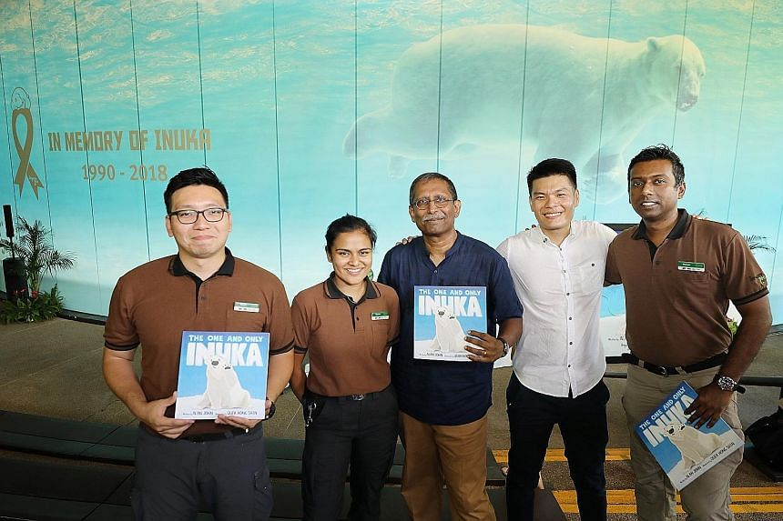 Mr Alan John and Mr Quek Hong Shin, with Inuka's caretakers (from left), Mr Stefan Ng, Ms Yasmin Basir and Mr Mohan Ponichamy. (From left) Author Alan John, Education Minister Ong Ye Kung, former minister S. Dhanabalan, who is chairman of Mandai Park