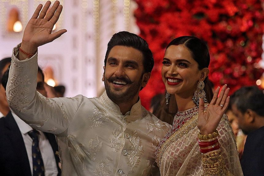 Ranveer Singh (far left, with his wife Deepika Padukone) plays a corrupt police officer turned good in Simmba (above).