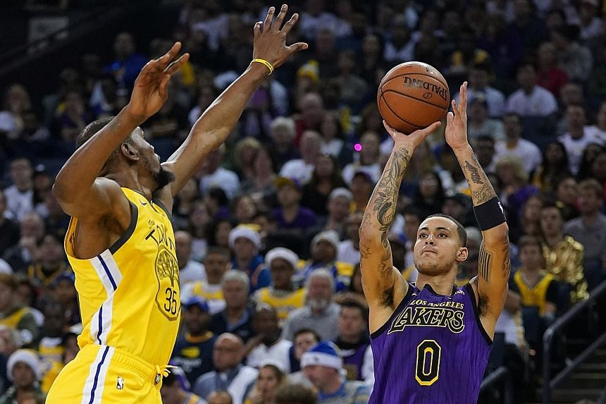 Left: Los Angeles Lakers star LeBron James grimacing in pain on the bench after he injured his groin against the Golden State Warriors during the second half of the Lakers' 127-101 upset win on Tuesday. The victory snapped an 11-game losing streak on
