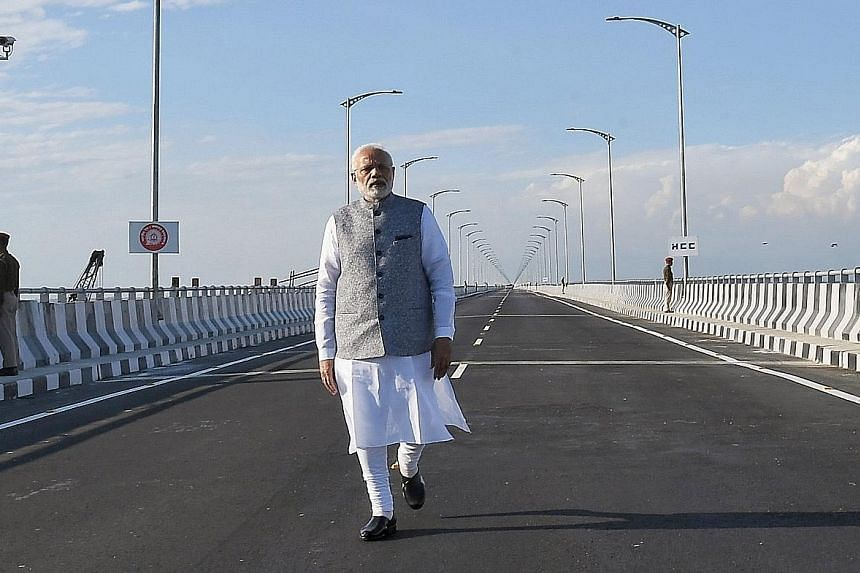 Indian Prime Minister Narendra Modi is shown in an Indian Press Information Bureau photo at the dedication of Bogibeel Bridge in Dibrugarh, Assam, on Dec 25.