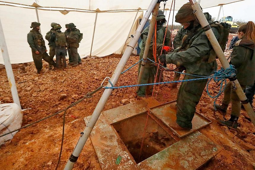 An Israeli soldier operating a pulley on Dec 19 at an entry point to a tunnel which reportedly connects Lebanon and Israel.