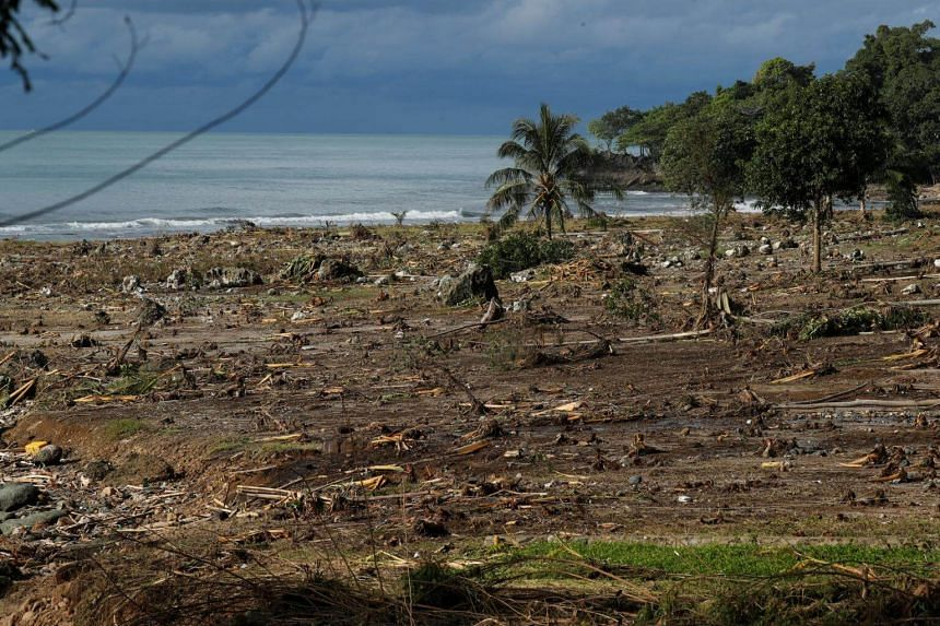Debris is seen along a beach after a tsunami, near Sumur, Banten province, on Dec 26, 2018.