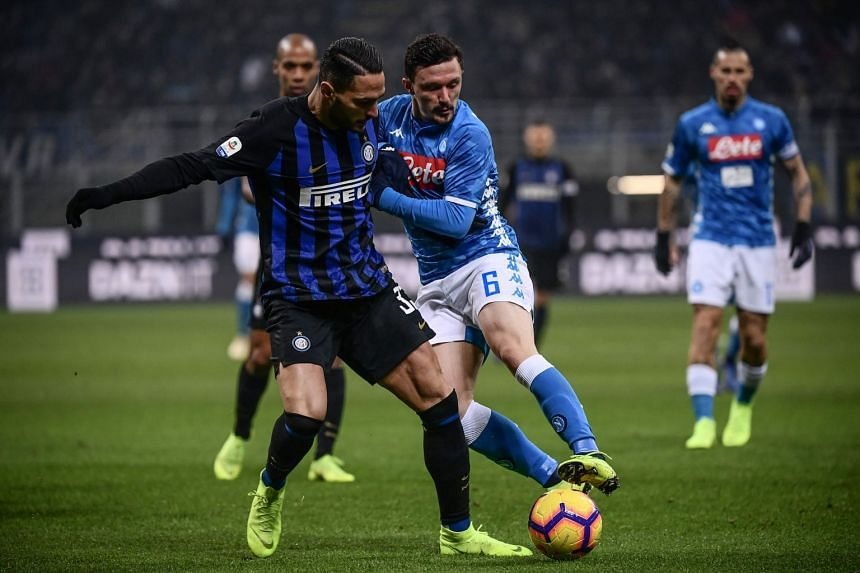 Inter Milan's Danilo D'Ambrosio and Napoli's Mario Rui in action during their Italian Serie A match at the San Siro stadium in Milan on Dec 26, 2018.
