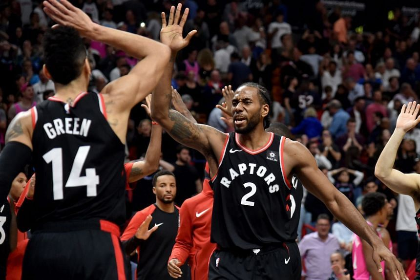 Toronto Raptors forward Kawhi Leonard (right) celebrates with guard Danny Green after defeating the Miami Heat at the American Airlines Arena on Dec 26, 2018.