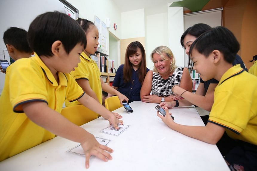 Finland's Ambassador to Singapore Paula Parviainen takes Mission:SG host Lee Yu Ting (third from left) to Dreamkids pre-school to learn about the Finnish early childhood education model.