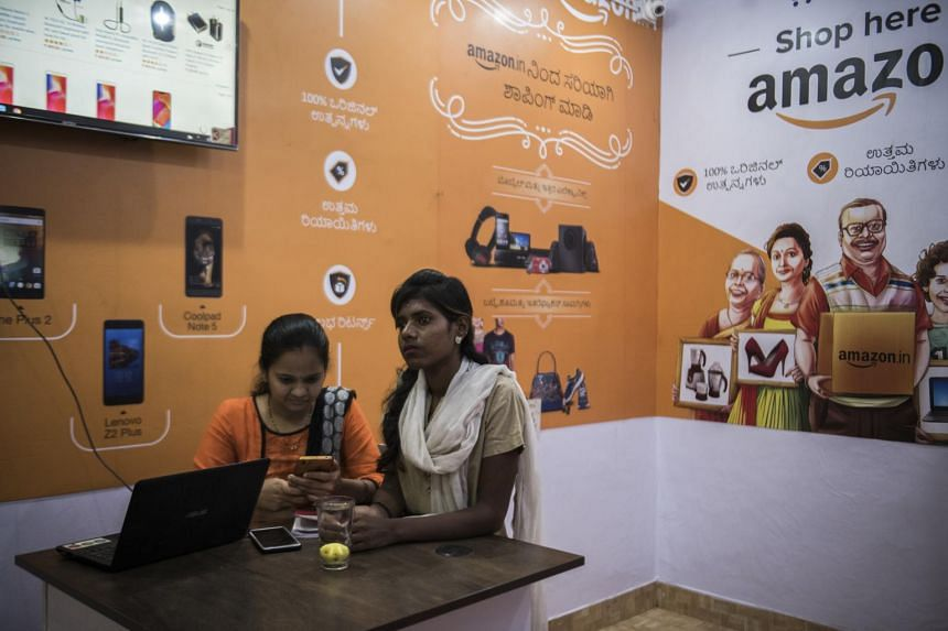 Employees at an Amazon order and collection point in Tumakuru, India, on Dec 4, 2018.