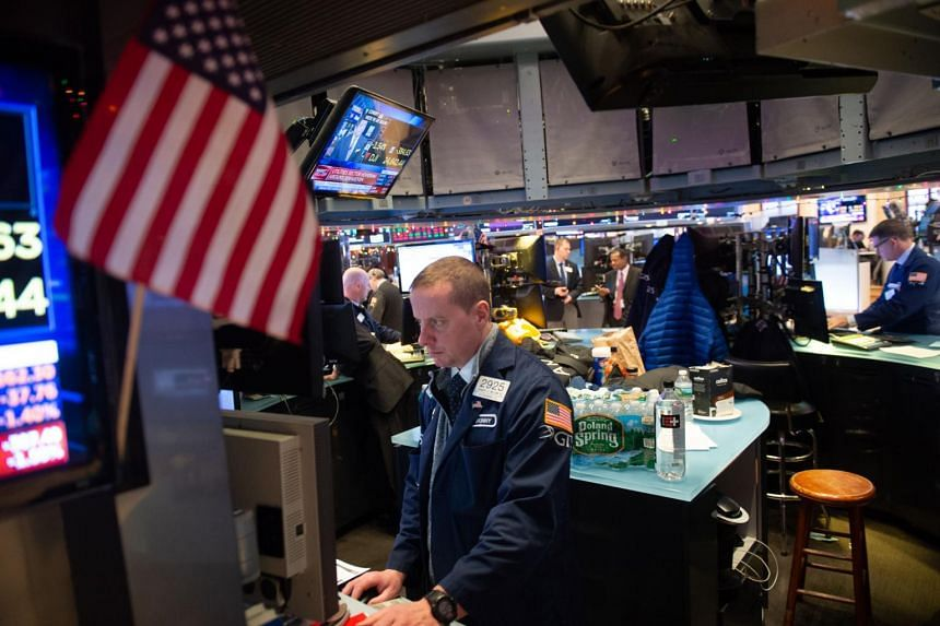 Traders work on the floor at the opening bell of the Dow Industrial Average at the New York Stock Exchange, on Dec 6, 2018.