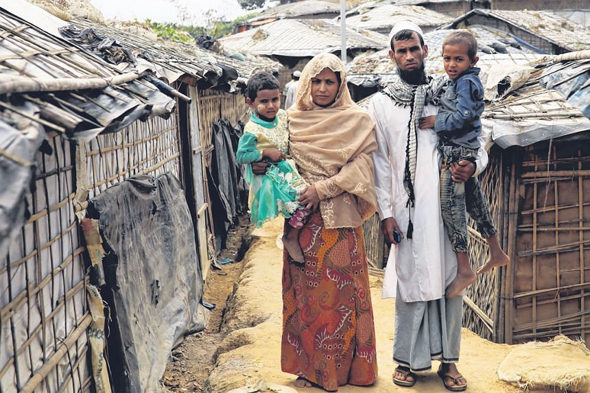 Rohingya Muslim Kalim Ullah, his wife Taiyeba Begum and their children are taking shelter in their relatives' tent at a camp in Bangladesh to avoid forced repatriation to Myanmar.