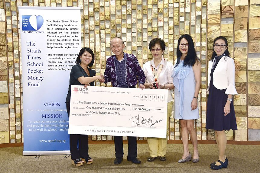 From left: The Straits Times School Pocket Money Fund general manager Tan Bee Heong, Life Art Society president Tan Khim Ser, Mr Tan's wife, Life Art Society treasurer Gladys Shan and ST reader Yang Shwn Fen at the cheque presentation in Singapore Pr