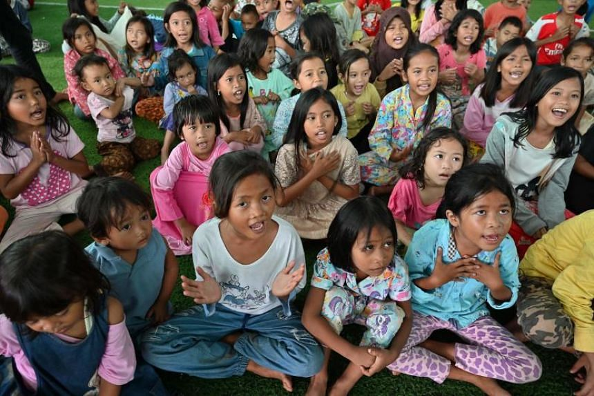 Children take part in a trauma healing programme for those displaced by a deadly tsunami in Labuhan, Banten Province, on Dec 27, 2018.