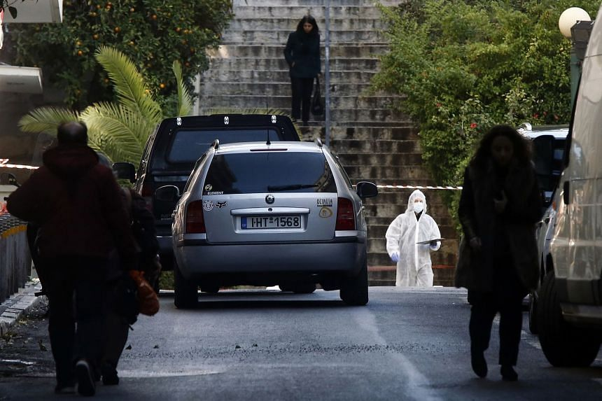 Police officers at the scene outside the church in central Athens, Greece.