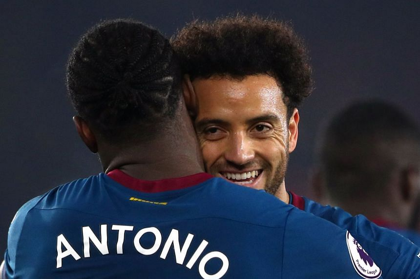 West Ham's Felipe Anderson celebrates with Michail Antonio after the match.