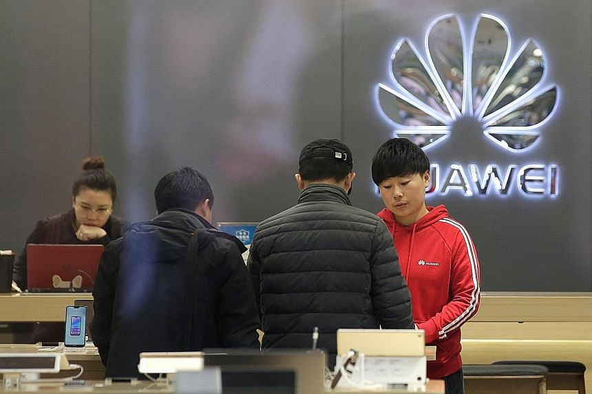A Huawei store in Beijing. The company would report sales revenue of US$108.5 billion (S$149 billion), up 21 per cent year on year, rotating chairman Guo Ping said in a New Year message to staff. He also said the firm had signed 26 commercial deals f