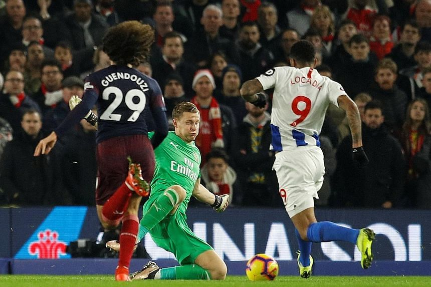 Brighton's Jurgen Locadia taking the ball past Bernd Leno to score his first goal of the season as his team drew 1-1 with Arsenal in the Premier League on Wednesday. The forward had a free run on goal after a long ball was headed into his path by Ars