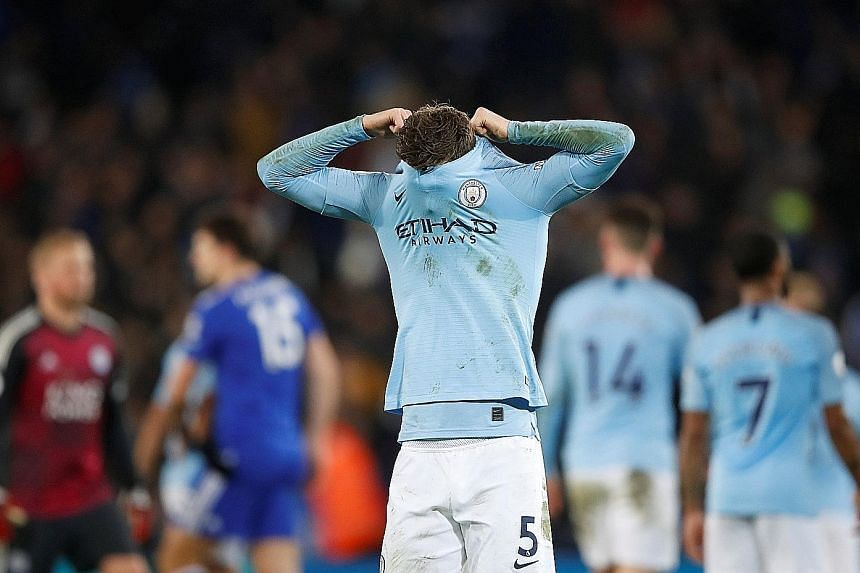 Manchester City defender John Stones hiding his disappointment at the end of the 2-1 Premier League defeat by Leicester at the King Power Stadium on Wednesday. League champions City are now on 44 points, one behind Tottenham and seven behind leaders