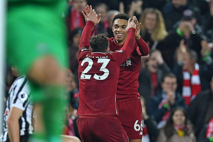 Liverpool's Trent Alexander-Arnold celebrating with Xherdan Shaqiri (No. 23) after laying on the ball for the Swiss midfielder to score in the 4-0 win over Newcastle on Boxing Day.