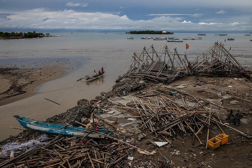 Above: The trail of damage left by the tsunami in Sumur last Saturday. At least 430 people have been killed, with 1,495 others injured and another 159 missing, after the tsunami slammed into coastal areas in western Java and south Sumatra. Left: Surv