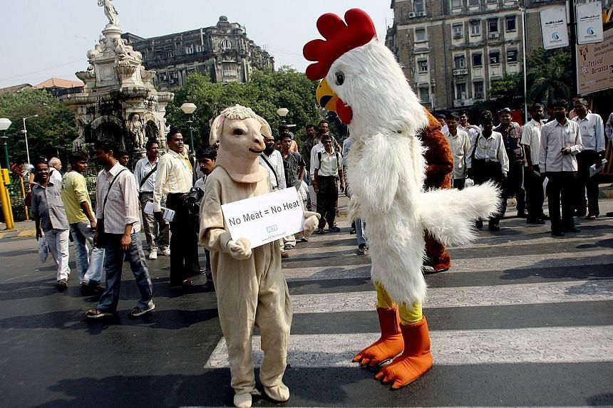 A demonstration to promote vegetarianism by People for the Ethical Treatment of Animals in Mumbai earlier this month. Reports show that vegetarianism in India has declined over the past decade.