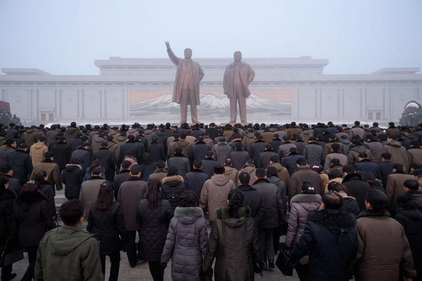 North Koreans prepare to bow before the statues of late leaders Kim Il Sung and Kim Jong Il on Mansu Hill in Pyongyang, on Dec 17, 2018.