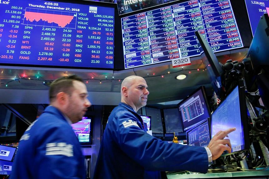 Traders working on the floor of the New York Stock Exchange (NYSE), on Dec 27, 2018.