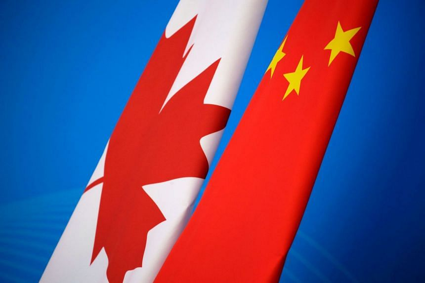 The flags of Canada and China are seen ahead of a dialogue in Beijing on Nov 12, 2018.