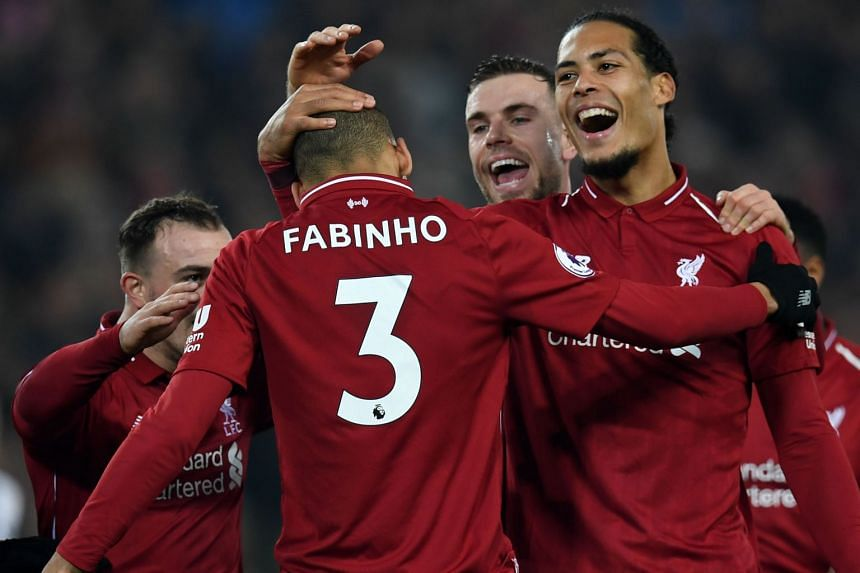 Liverpool's Brazilian midfielder Fabinho (centre) celebrates with team mates after scoring their fourth goal against Newcastle United on Dec 26, 2018.