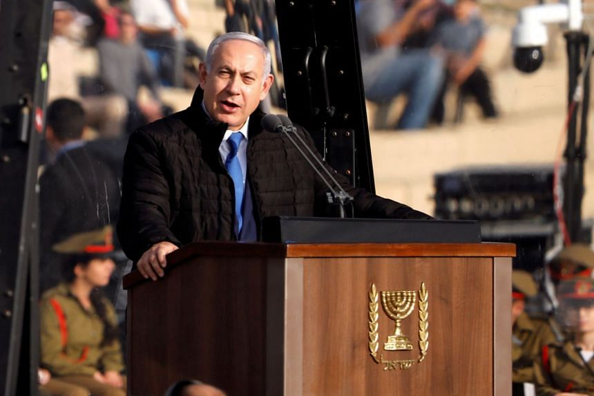 Israeli Prime Minister Benjamin Netanyahu speaks at the Israeli Air Force pilots' graduation ceremony at Hatzerim air base in southern Israel, on Dec 26, 2018.