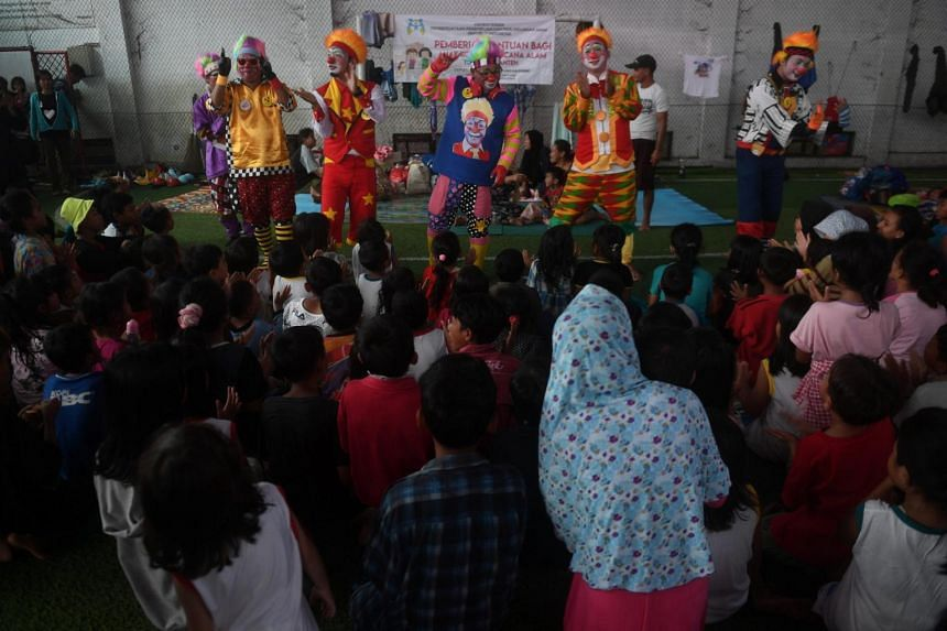 Clowns dance as they entertain children who were affected by the tsunami, at a temporary shelter in Pandeglang, Banten, Indonesia on Dec 27, 2018.