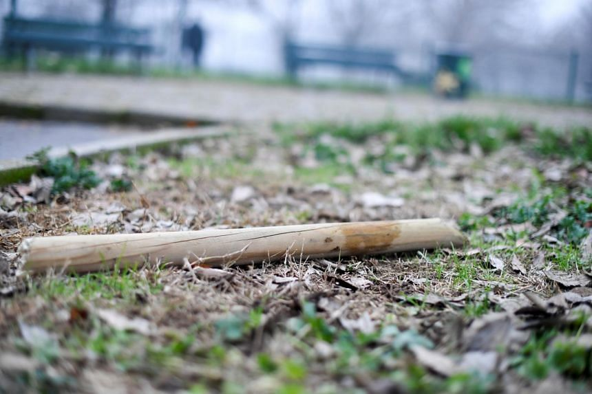 A wooden stick that was used in the clashes lies on the ground near Milan's San Siro stadium in Milan, Italy, on Dec 27, 2018.