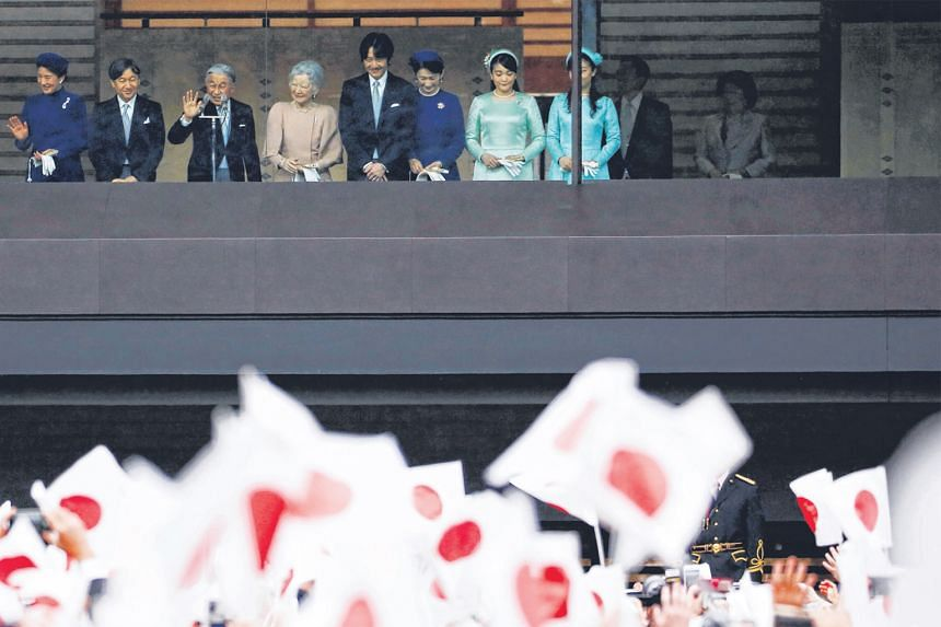 Emperor Akihito greeting well-wishers at the Imperial Palace in Tokyo on his 85th birthday on Dec 23. With him and Empress Michiko are (from left) Crown Princess Masako, Crown Prince Naruhito, Prince Akishino and princesses Kiko, Mako and Kako.