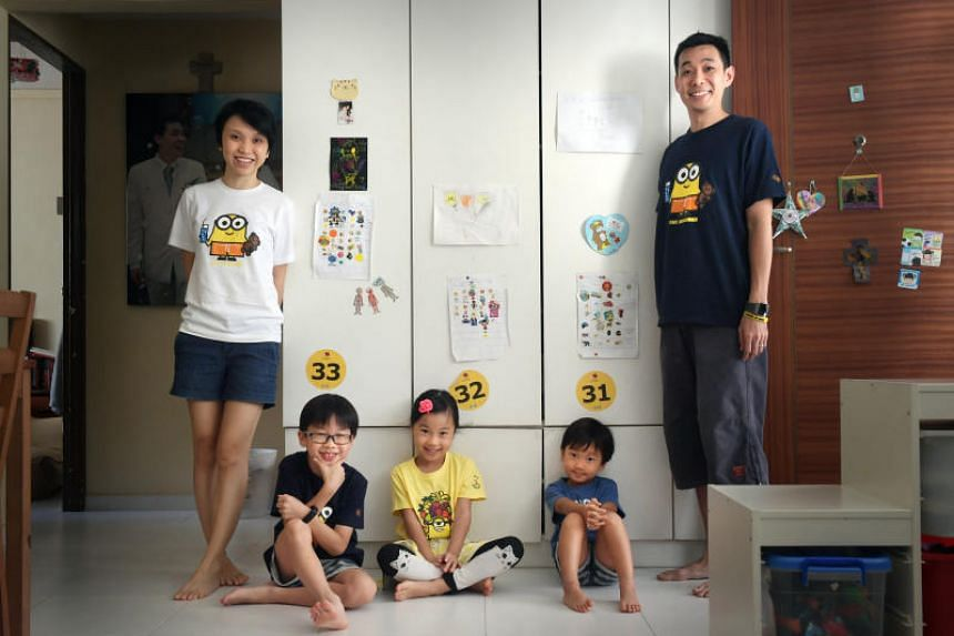 Parents Fannie Lim and Kevin Goh practice using rewards charts to build good habits with their children, Caleb, Hannah and Timothy.
