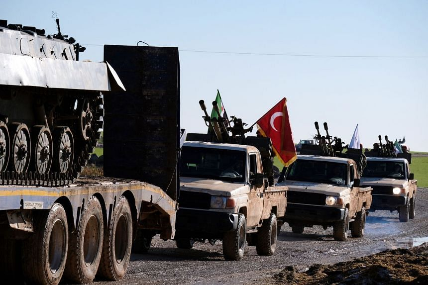 Turkish forces and members of the Turkish-backed Free Syrian Army move some 10km away from Manbij town in northern Syria.