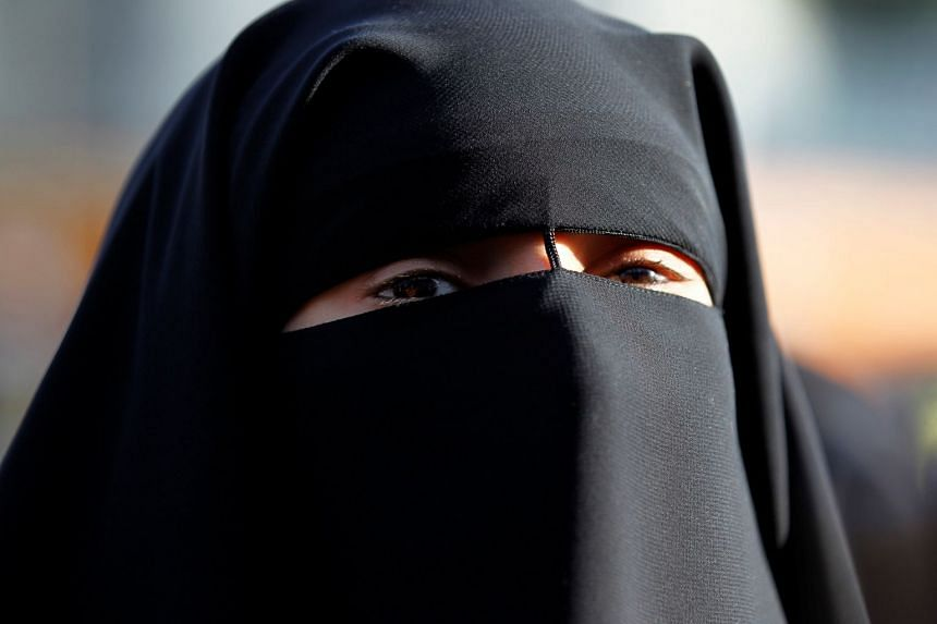 A woman wearling the niqab in France.