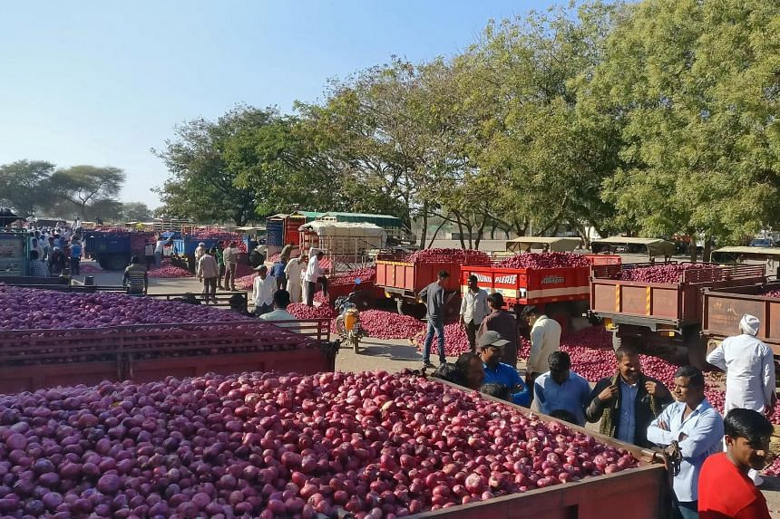Farmers waiting for an onion auction in Maharashtra on Dec 19. Onion prices have plunged to as low as one rupee (two Singapore cents) per kilogram for a crop that costs about eight rupees a kilogram to produce.
