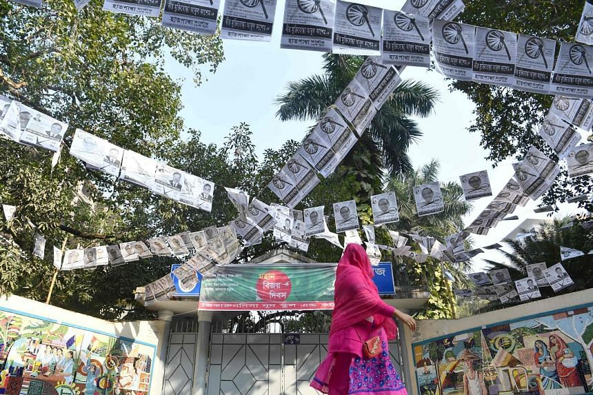 A street filled with election posters in Dhaka. The ruling Awami League is going up against a Bangladesh Nationalist Party-led opposition alliance in tomorrow's general election.