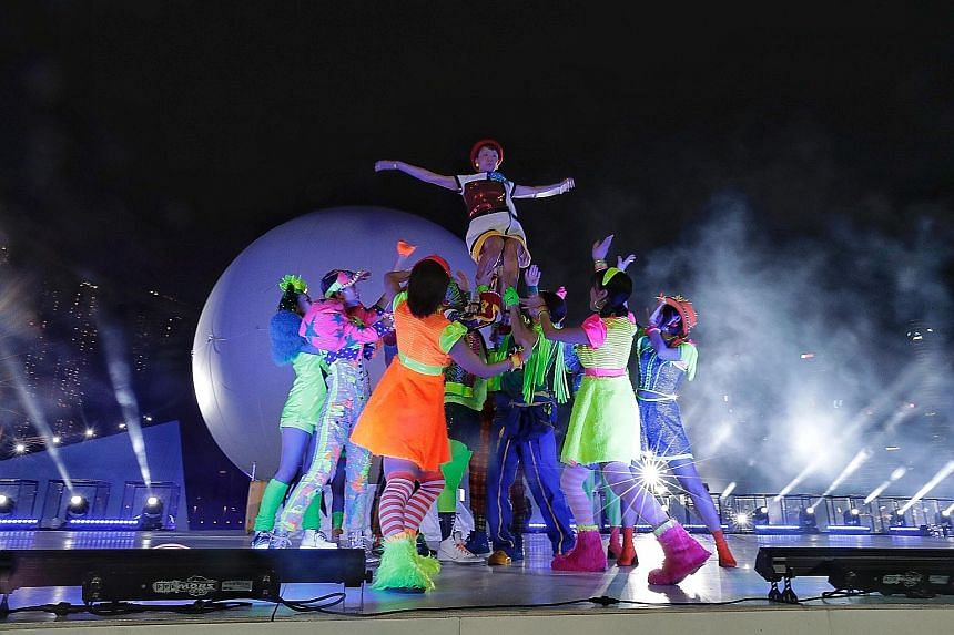 Performers practising a segment with light projections during a rehearsal for the Star Island Singapore Countdown Edition at The Float@Marina Bay yesterday. Presented outside of Japan for the first time, the hour-long show will be part of the Marina
