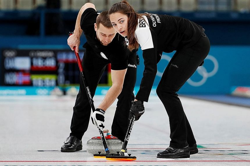 Russians Alexander Krushelnitsky and Anastasia Bryzgalova sweeping in the mixed-doubles curling at the Pyeongchang Olympics in February. He failed a doping test and they were stripped of their bronze medals.